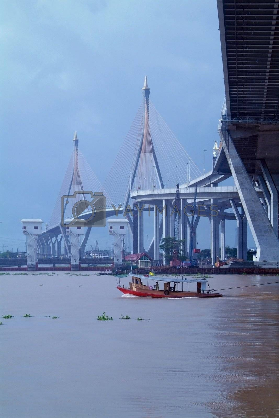 Royalty free image of Bridge and tug-boat in Bangkok, Thailand by epixx