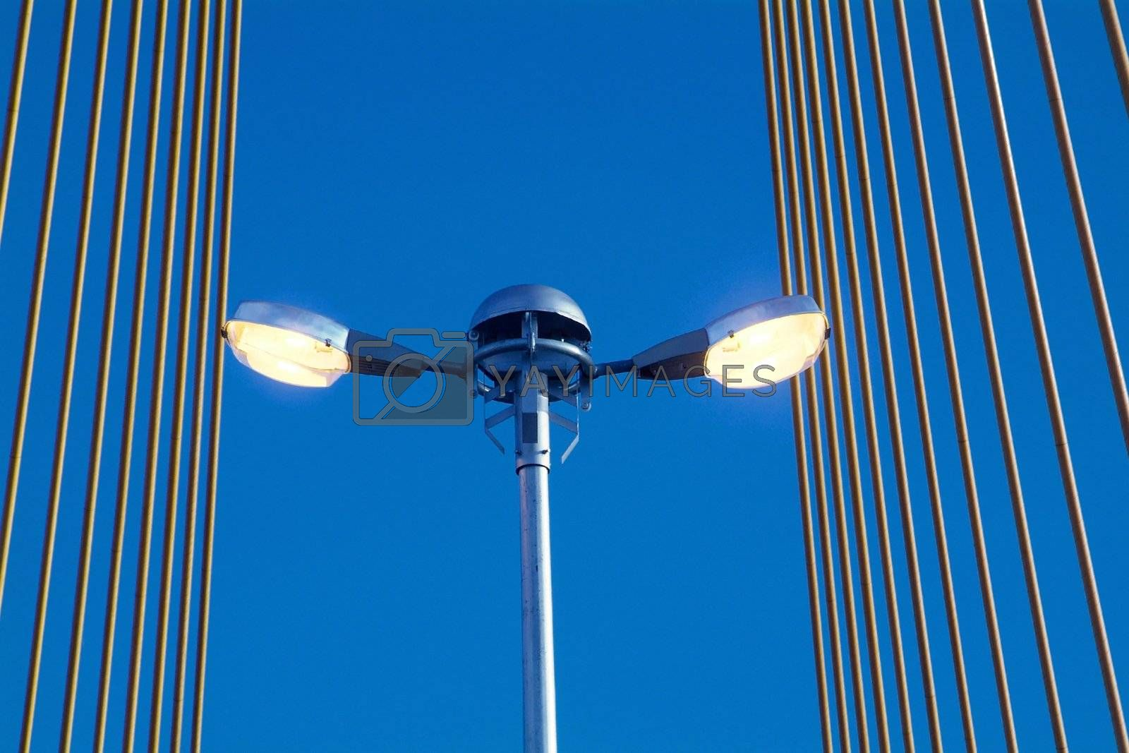 Royalty free image of Street light on bridge by epixx