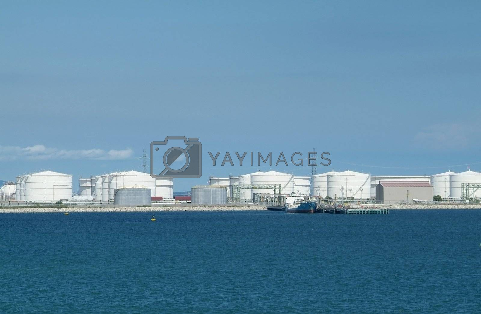 Royalty free image of harbour with oil storage tanks by epixx