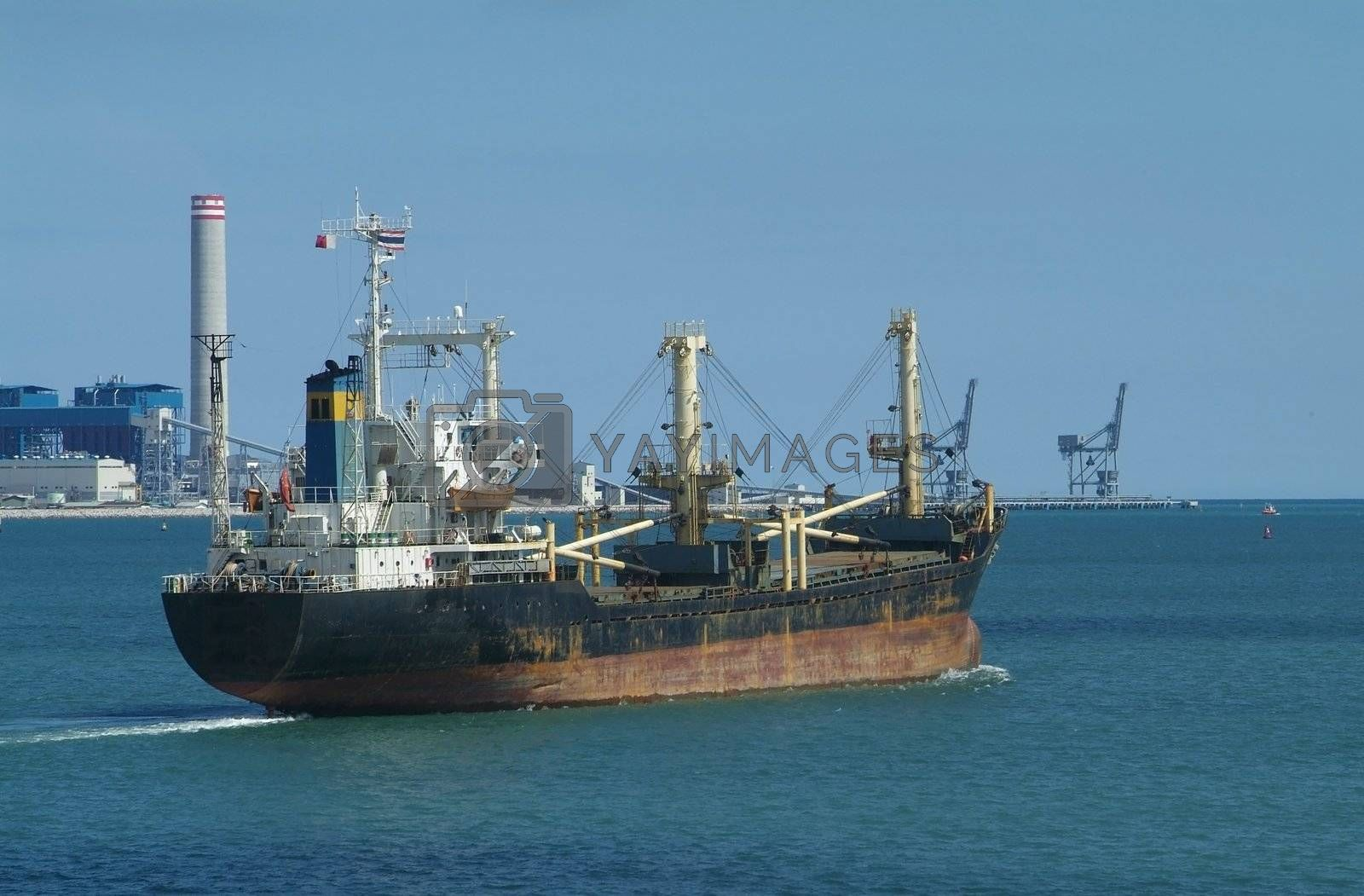 Royalty free image of Freight ship leaving port by epixx