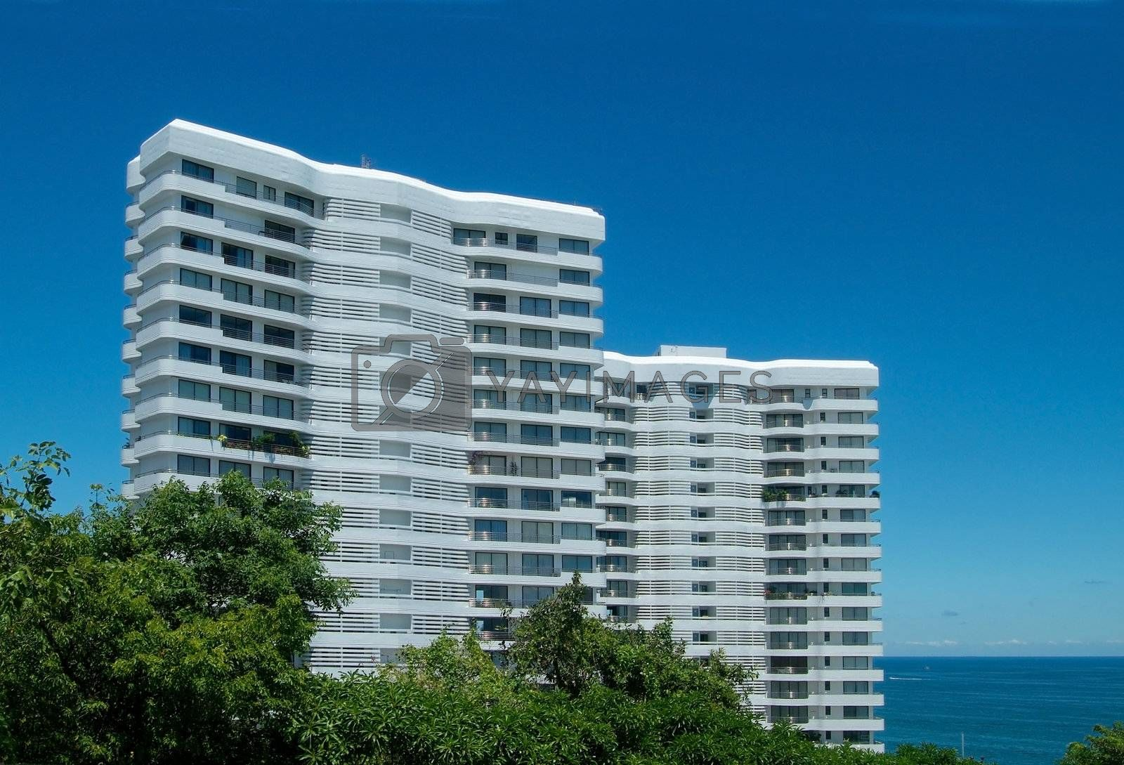 Royalty free image of Two apartment-buildings by the sea by epixx