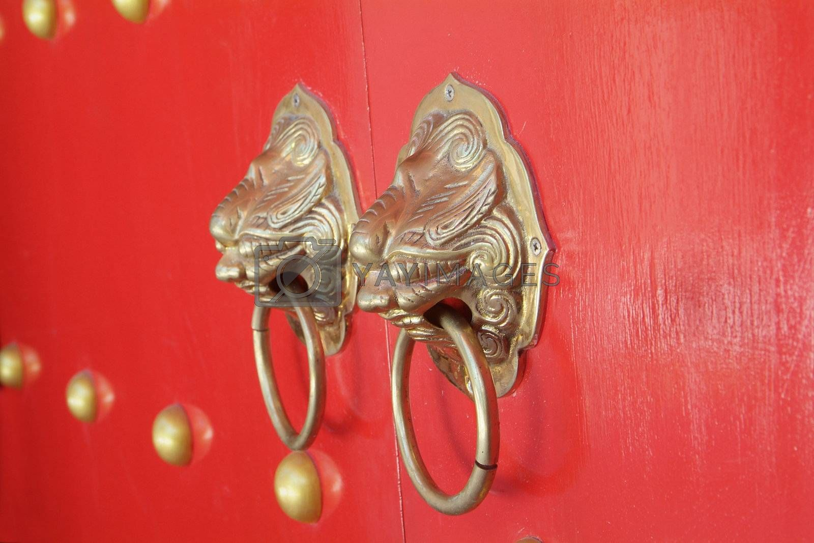 Royalty free image of Door handles at Chinese temple by epixx