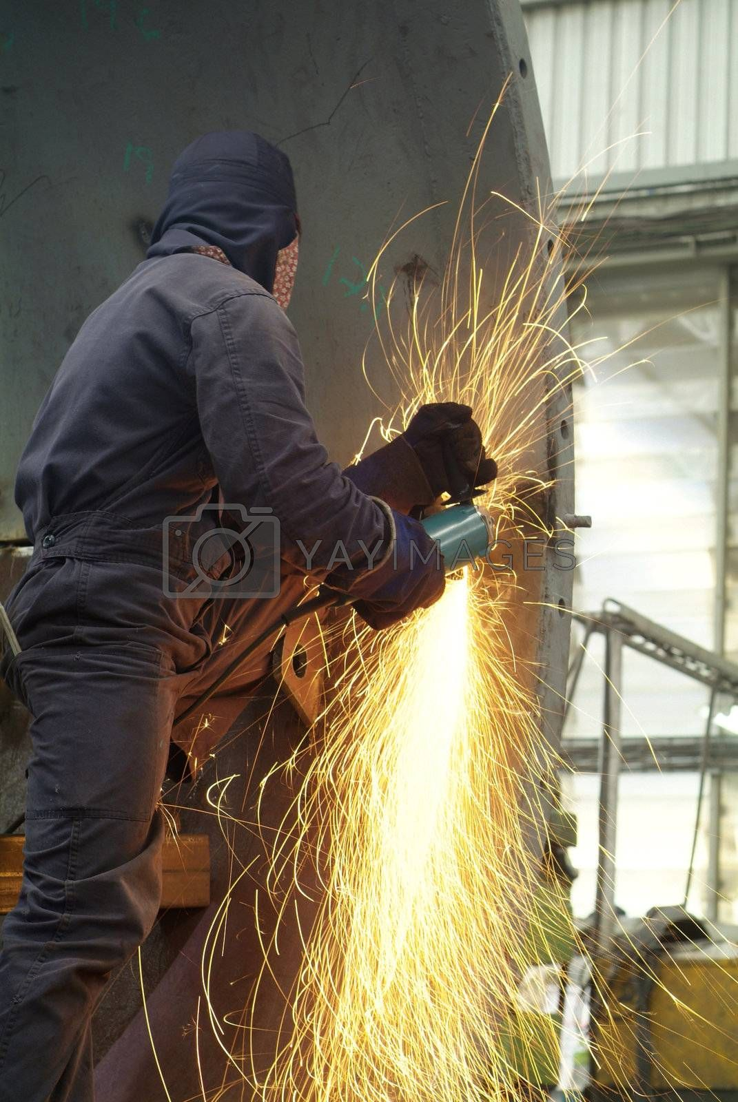 Man working with angle grinder by epixx