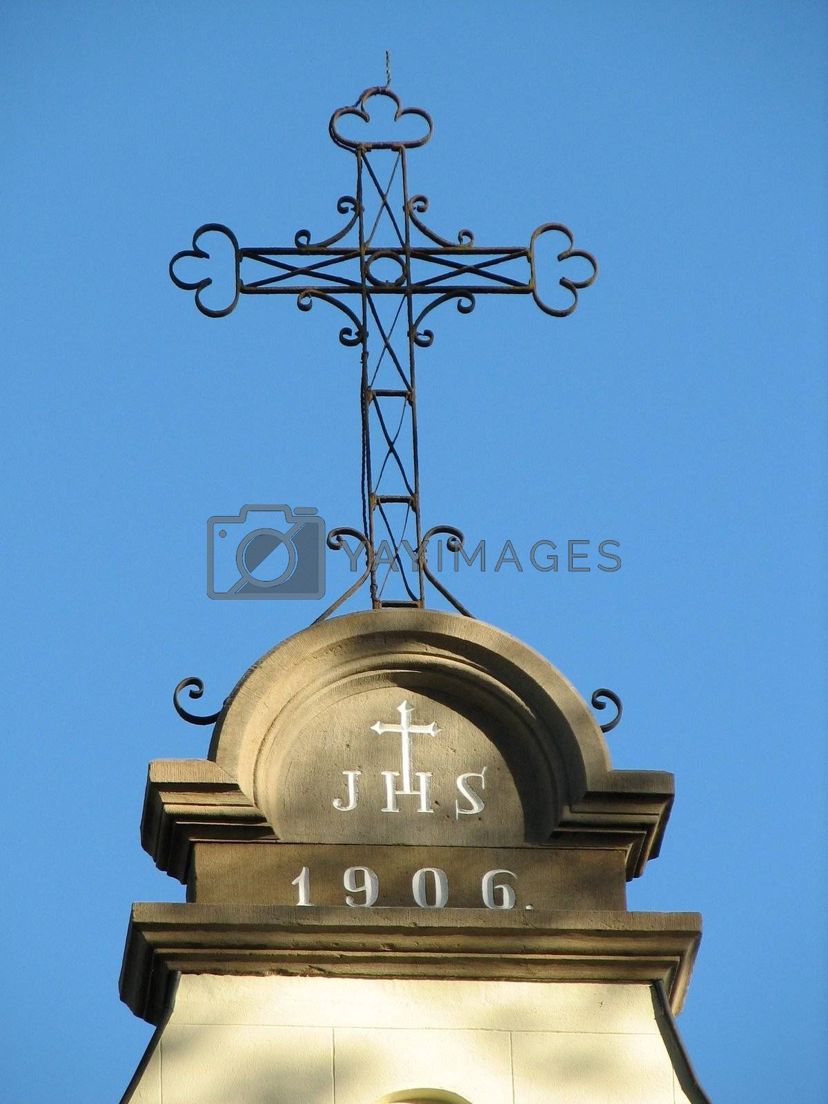 iron cross on top of a church