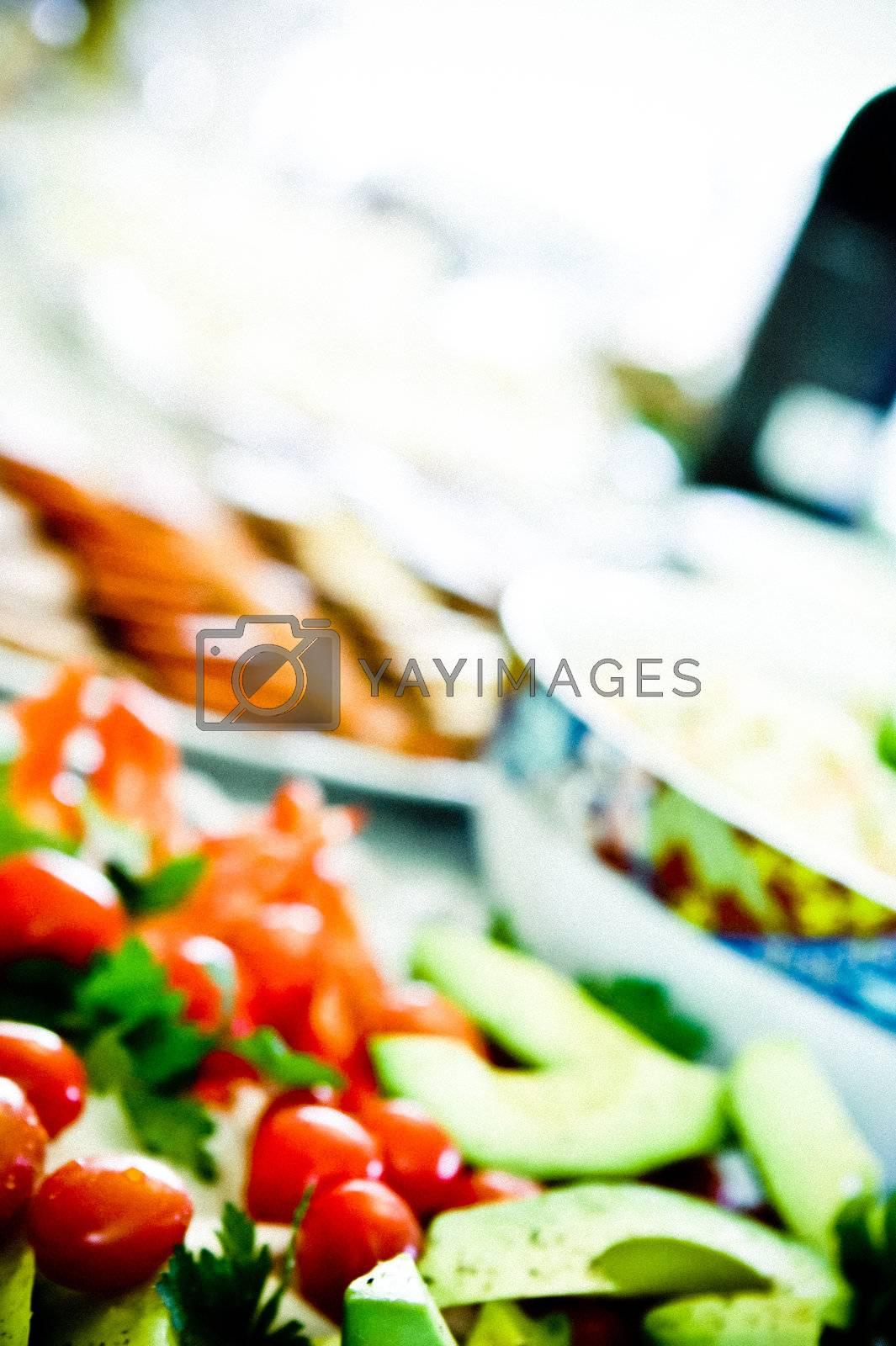 tomatos and avocado on a festive table