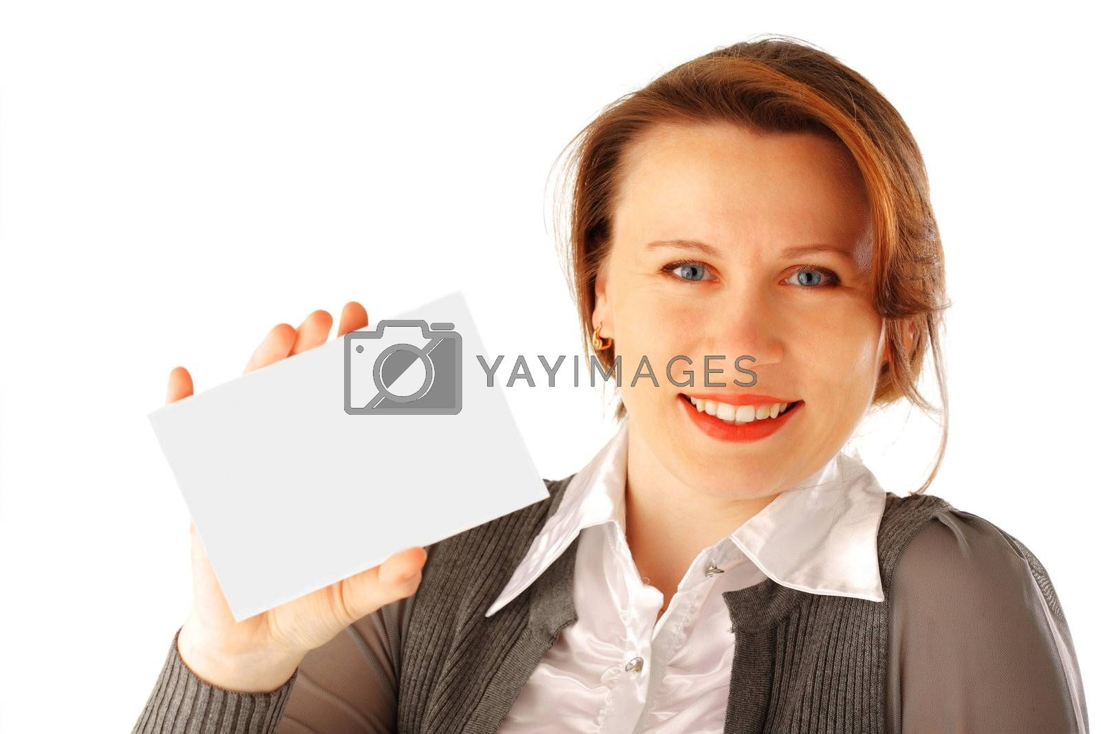 Young woman holding a blank card. She's smiling.