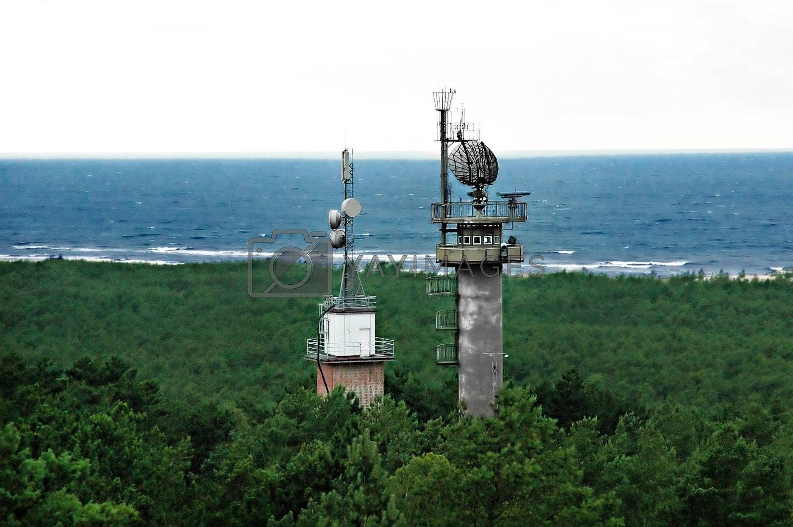 Military radar tower  in the forest near the sea shore