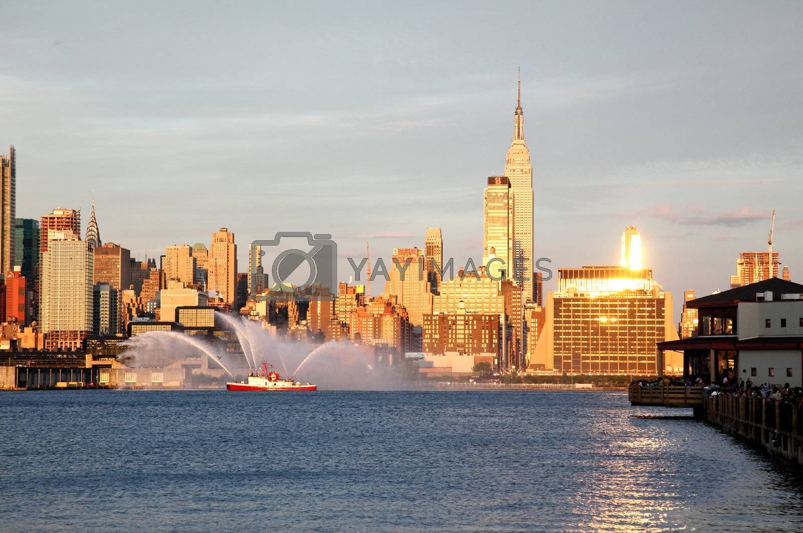 NEW YORK CITY - JULY 4, 2009: Fireboat waterjet show prior to the largest firework in the America - Macy's 4th of July fireworks which featured more than 40,000 shells.