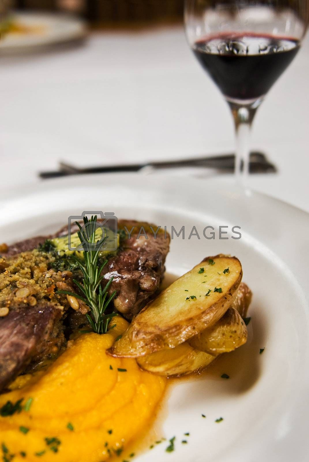 Meat, potato and pumpkin puree, served with red wine.