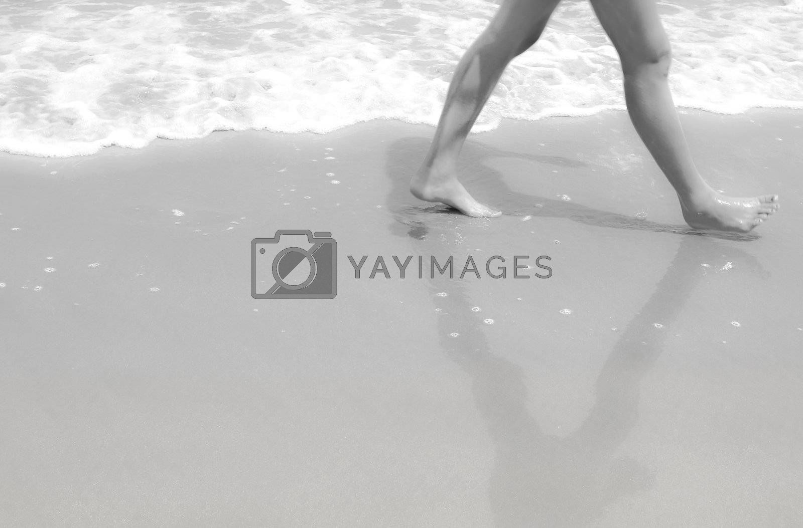 Legs walk on sand in black and white dreaming style