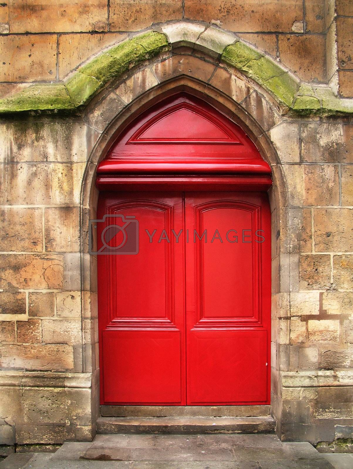 Red doors of the old stone cathedral by iribo