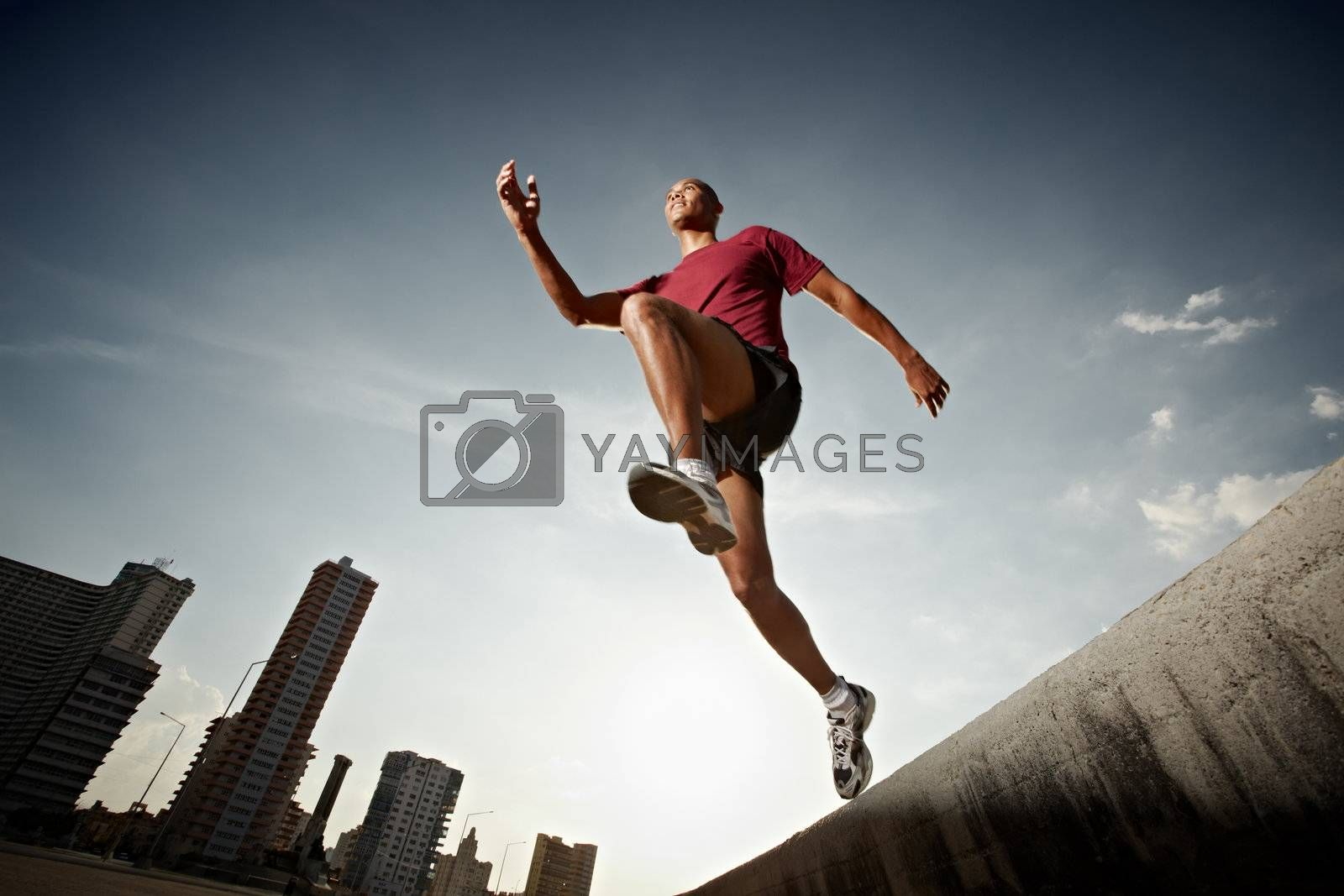 hispanic man running and jumping from a wall by diego_cervo