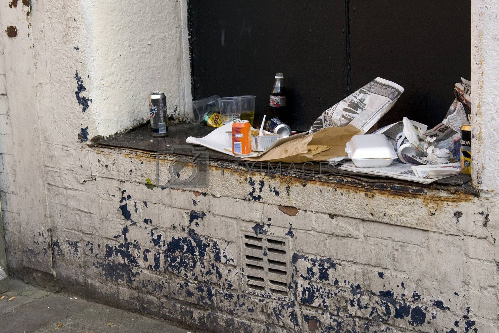 Rubbish left on a wall in an urban environment