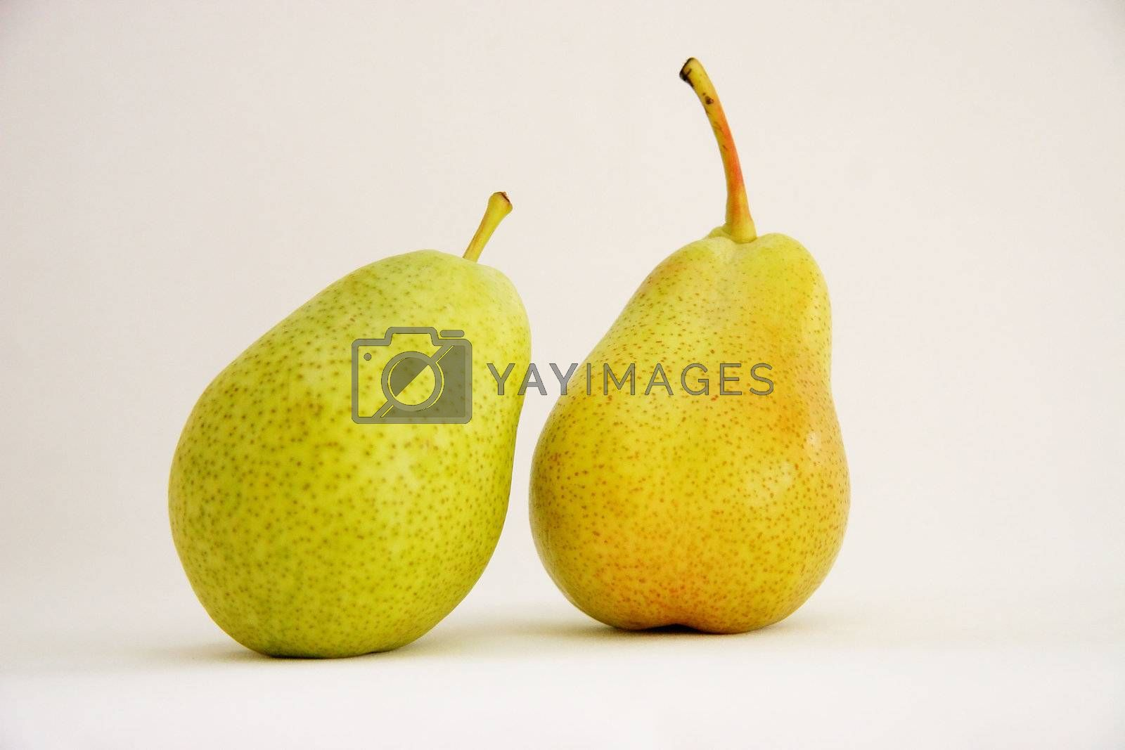 two portions of fresh fruit on a light background