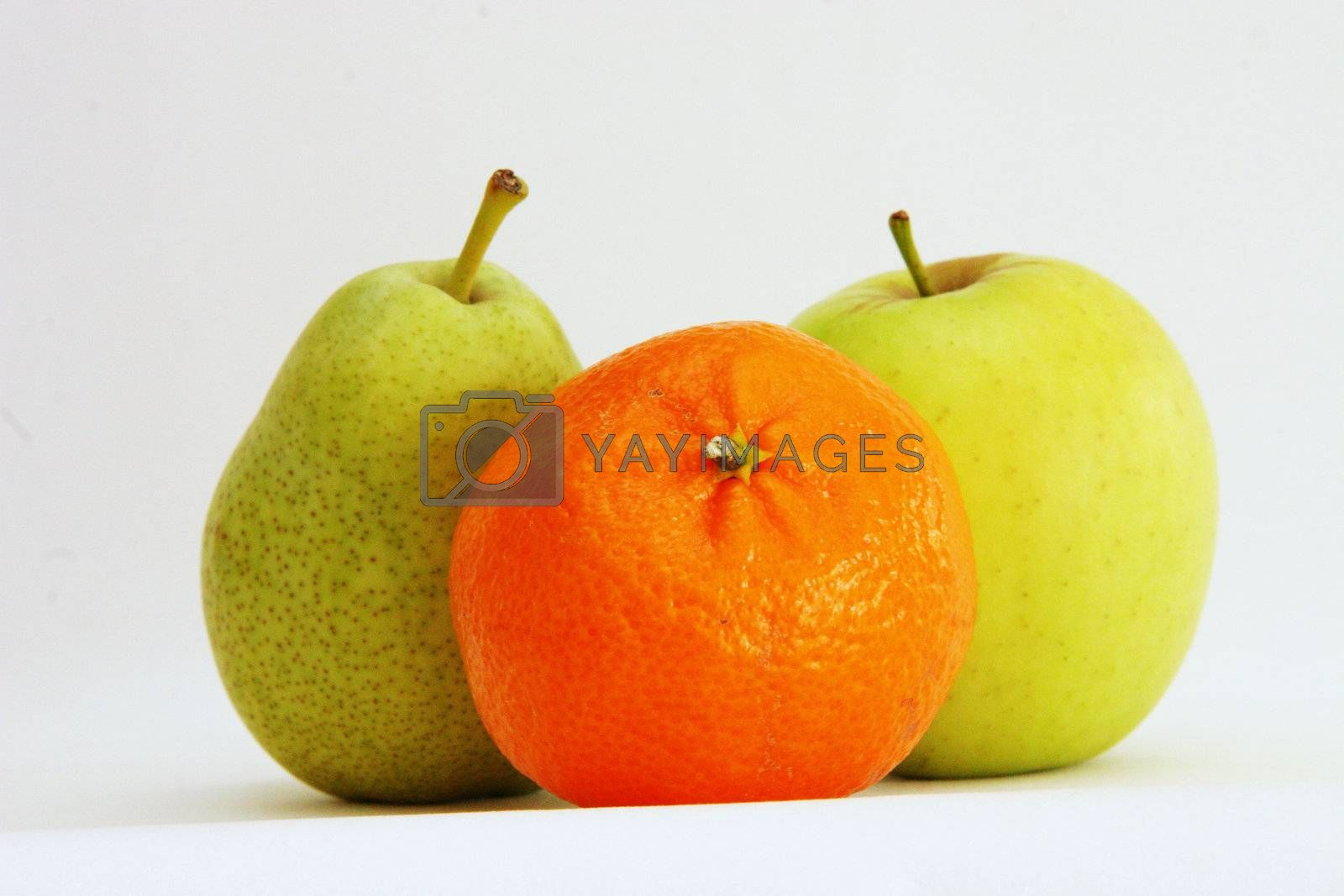 three portions of fresh fruit on a light background