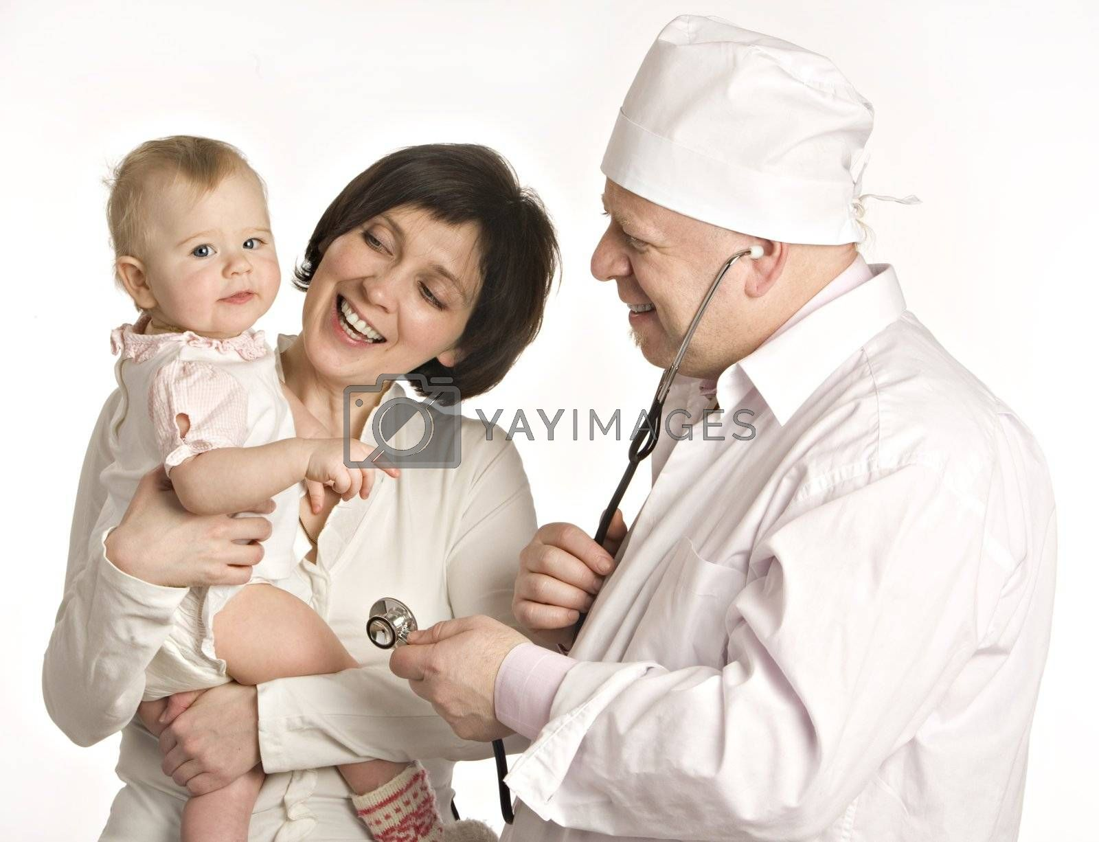 Smiling mum with the little girl on hands stands near to the doctor in white dressing gown on a white background