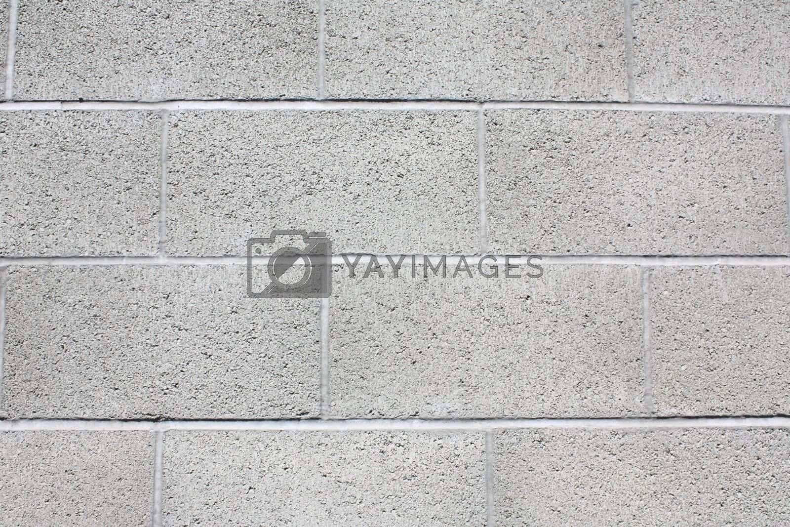 Royalty free image of Close-up of gray brick, cinderblock wall. by gregorydean