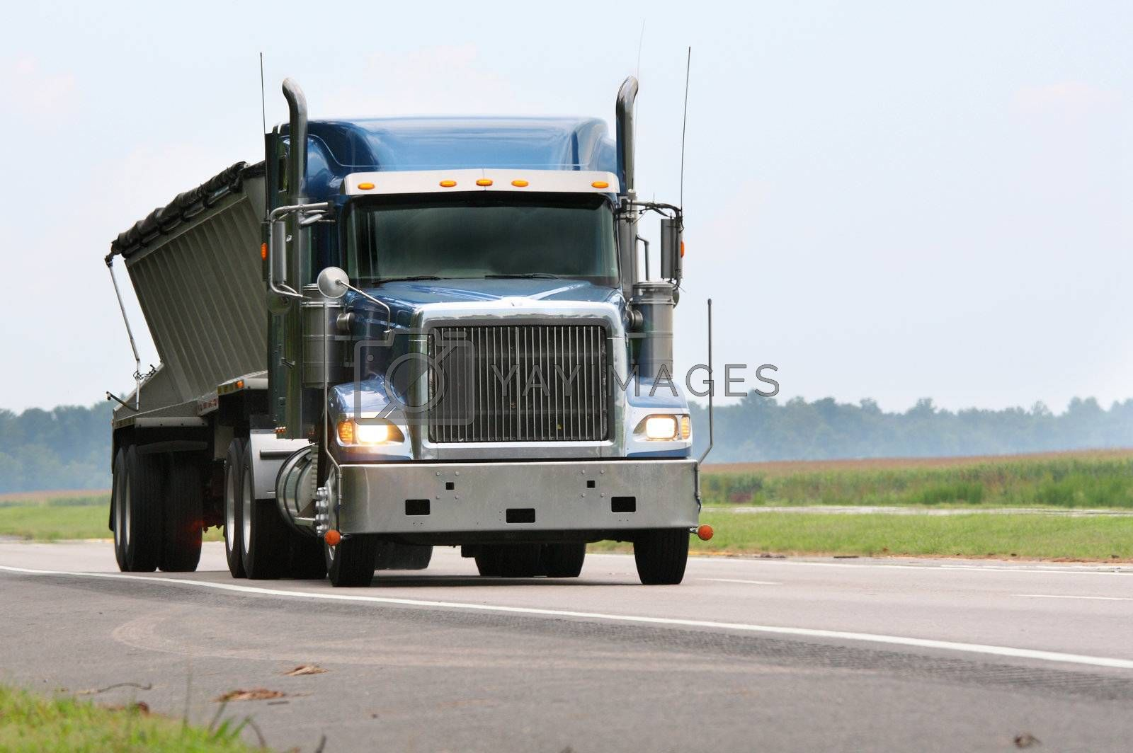 Royalty free image of blue cargo truck by gjdisplay