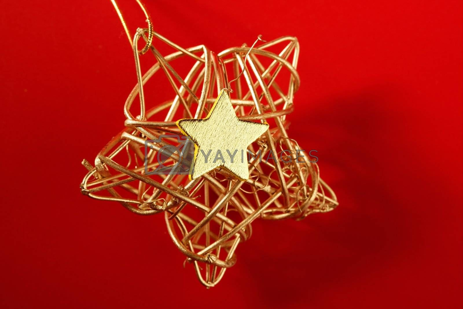 Royalty free image of Christmas golden decoration with gold star by lunamarina
