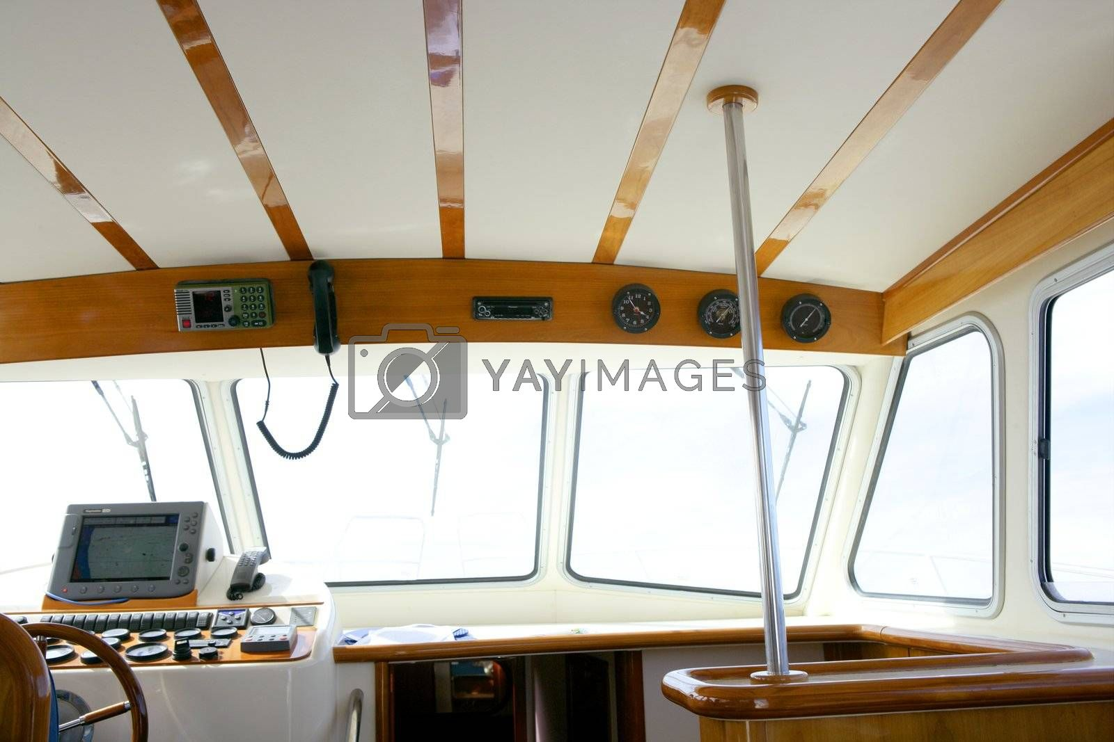 Royalty free image of Classic fishing boat white and wood interior by lunamarina
