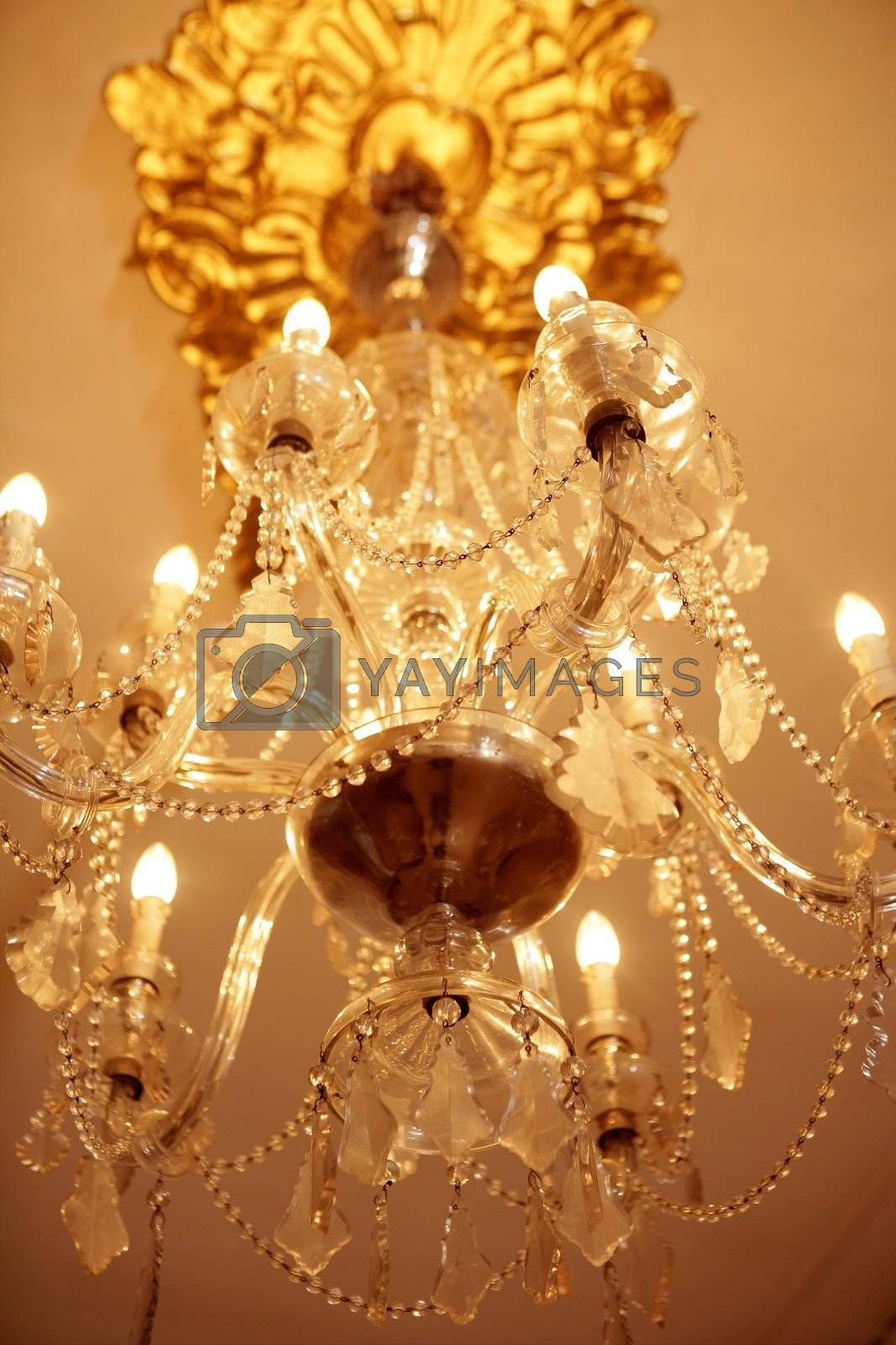 Royalty free image of Old electric chandelier lamp by lunamarina