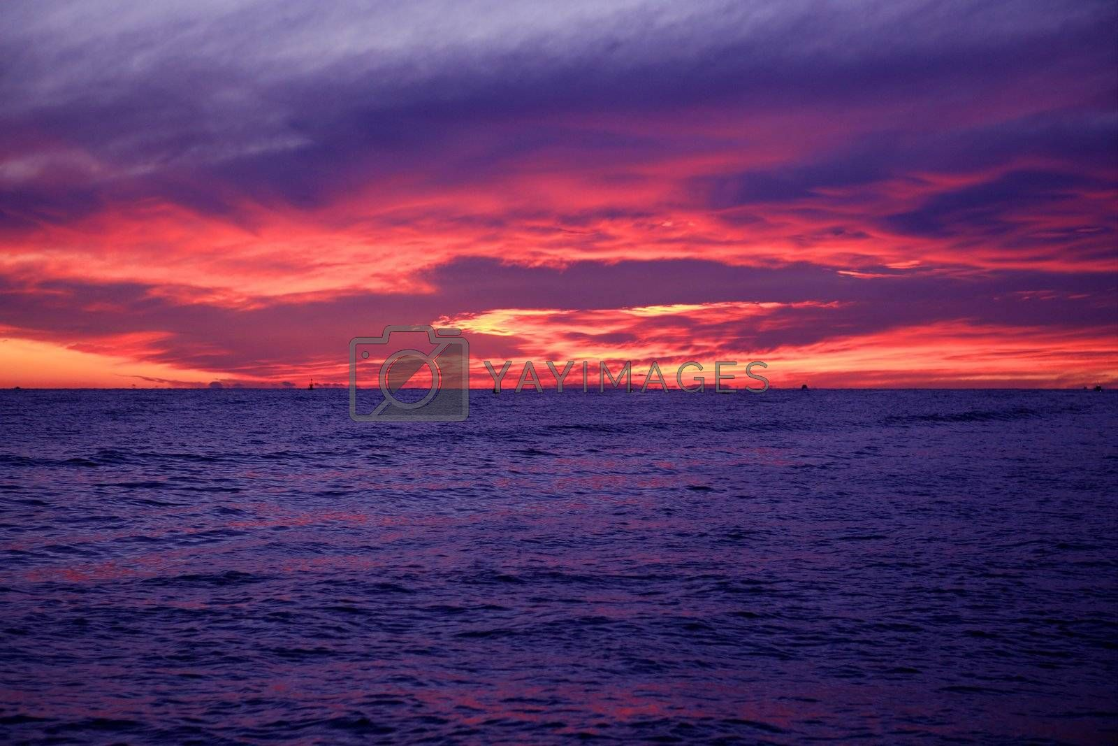 Royalty free image of Red and blue sunrise in Mediterranean sea by lunamarina