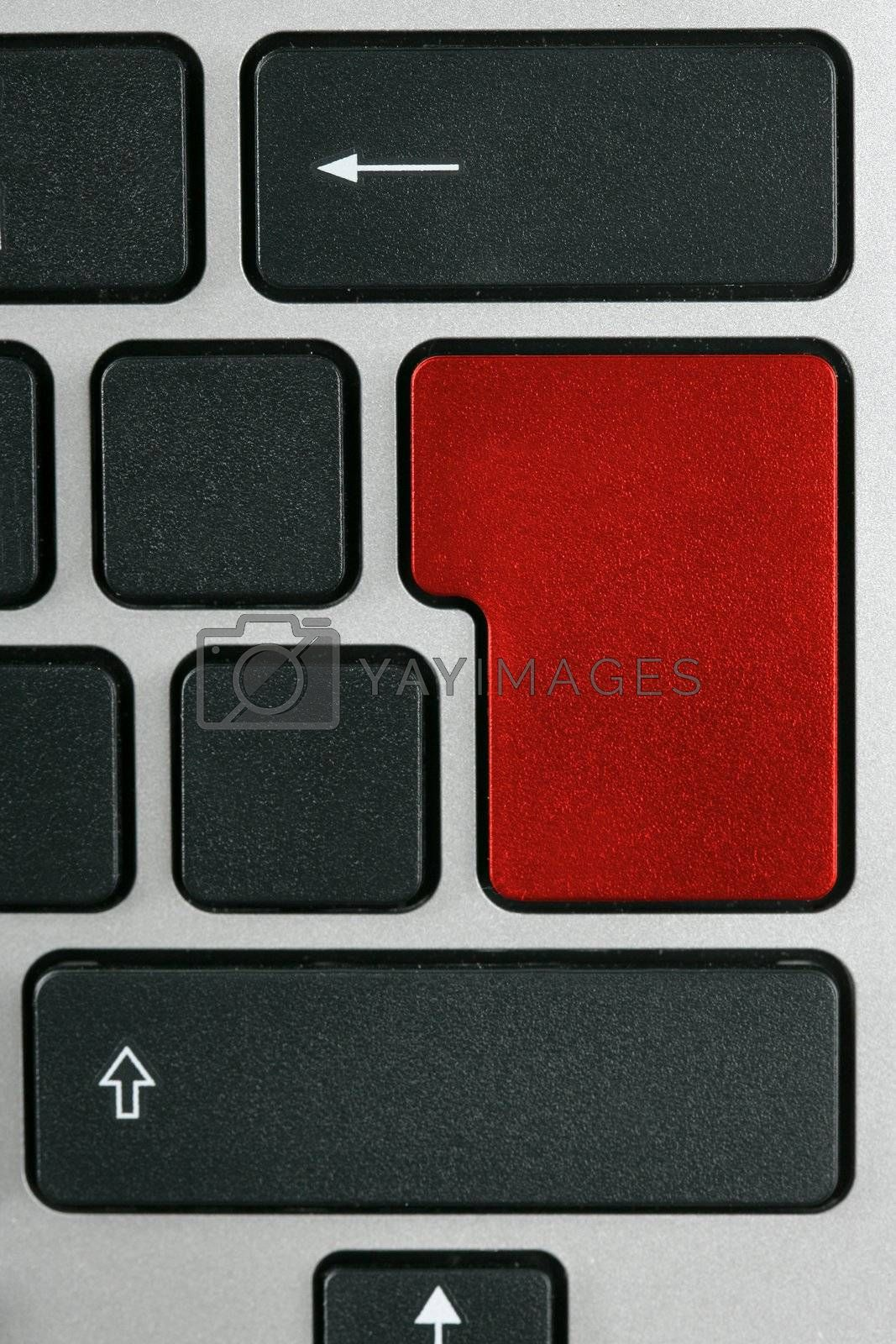 Royalty free image of Keyboard with enter key in red color by lunamarina