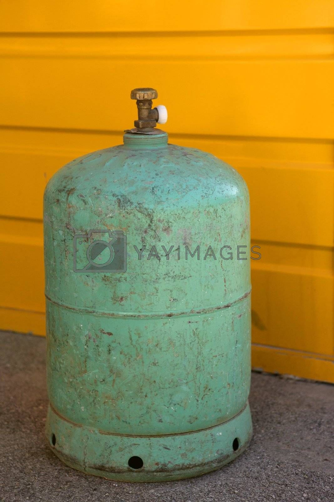 Royalty free image of Camping gas container, green over yellow by lunamarina