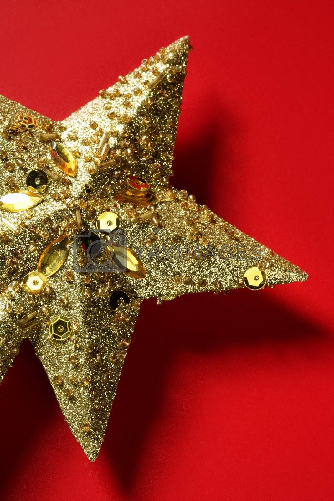 Royalty free image of Christmas star decoration still on red background by lunamarina