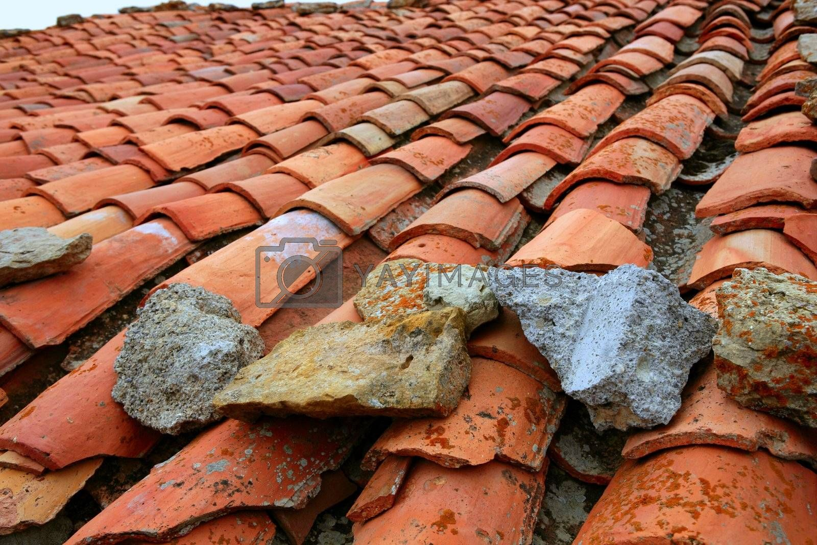 Royalty free image of Aged old red clay arabic roof tiles by lunamarina