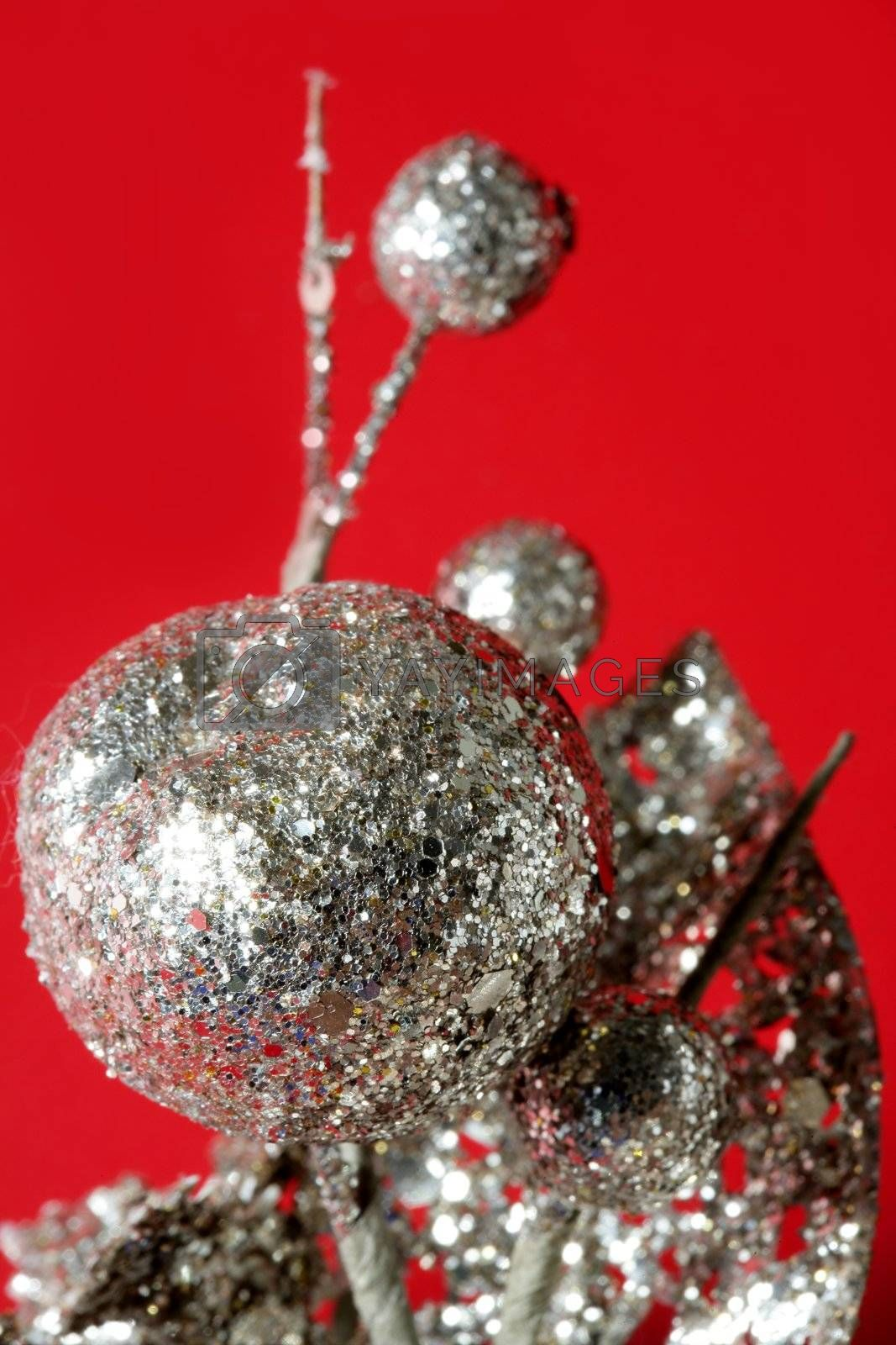 Royalty free image of Christmas decoration detail over red by lunamarina