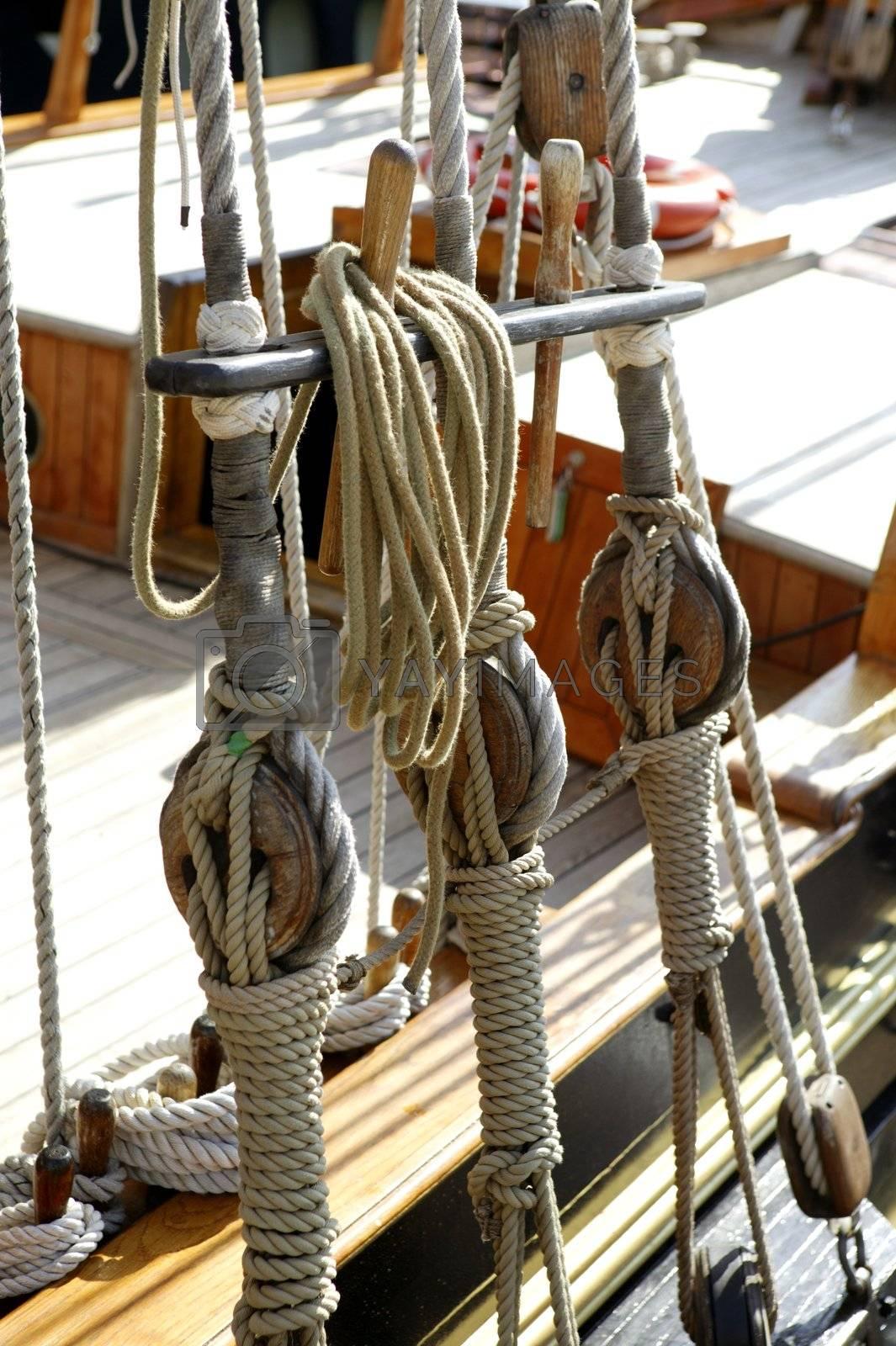 Royalty free image of Sailboat wooden marine rigs and ropes by lunamarina