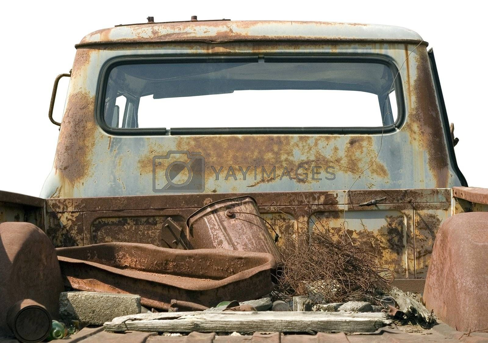 Rusted vintage truck truck bed filled with junk, isolated on a white background.