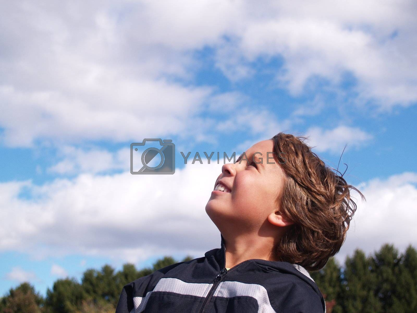 young boy looking up at the sky