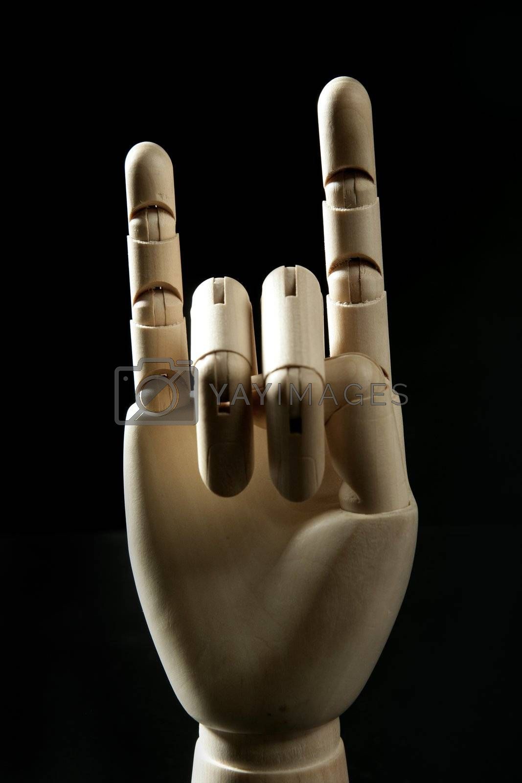 Royalty free image of Mannequin wooden hand, horns with fingers by lunamarina