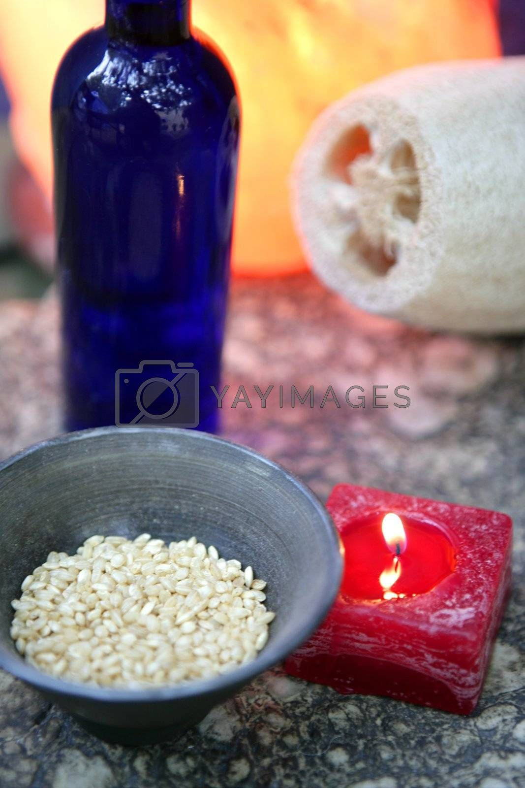 Royalty free image of Aromatherapy, red candle, marine natural sponge by lunamarina