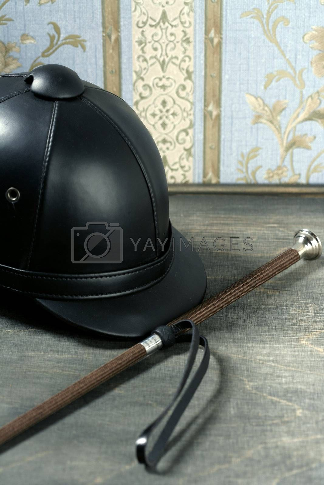 Royalty free image of Equiestrian black leather hat still detail by lunamarina