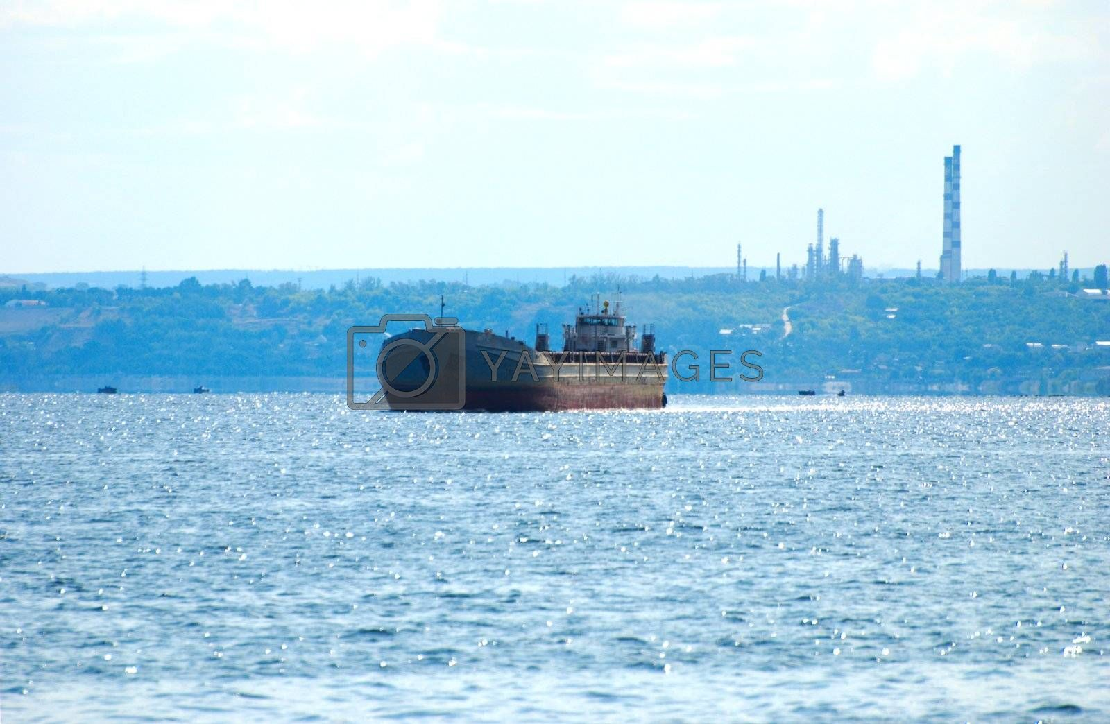 Royalty free image of The oil tanker floating down the Volga by Light