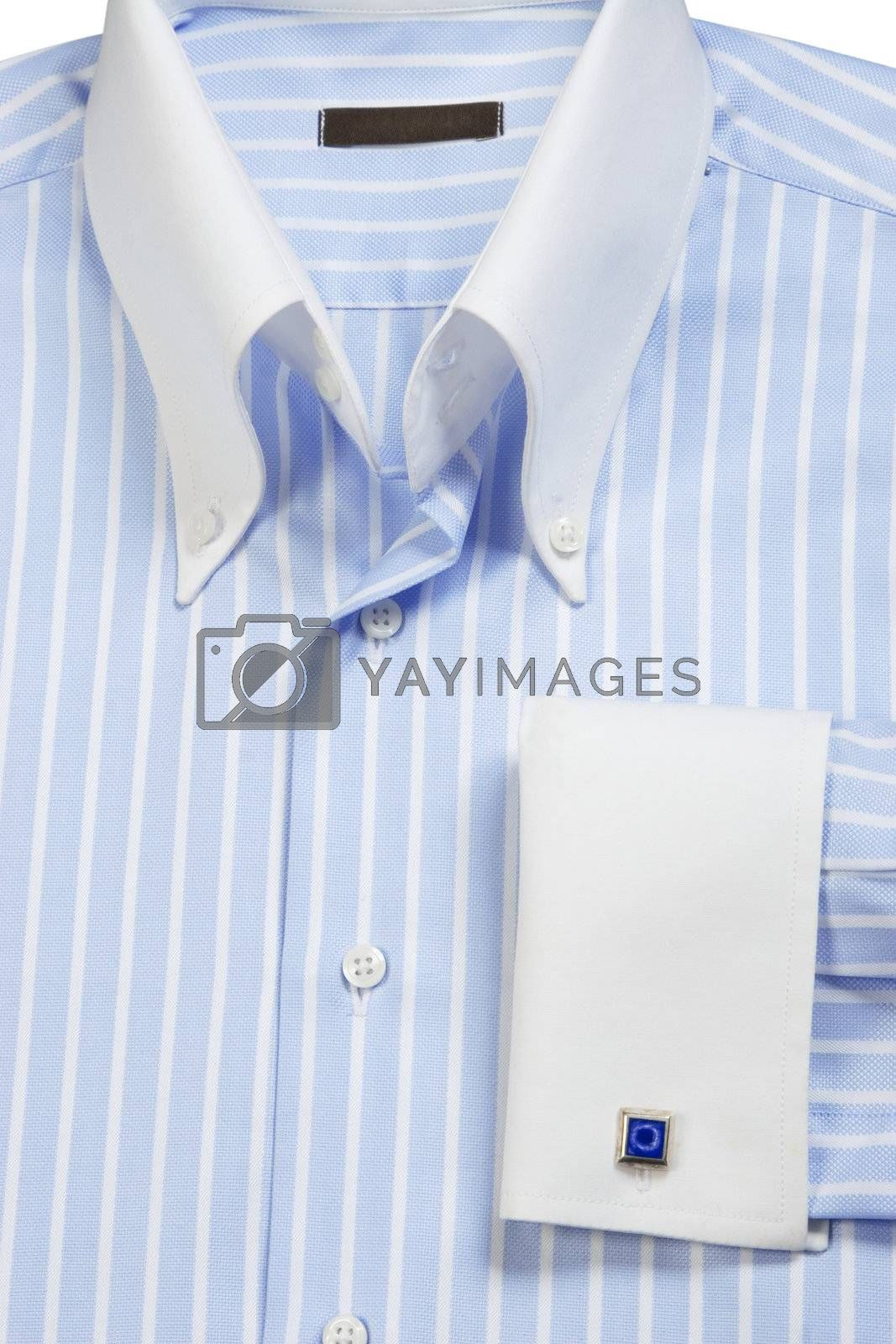 Close-up of cuff-link on blue striped shirt