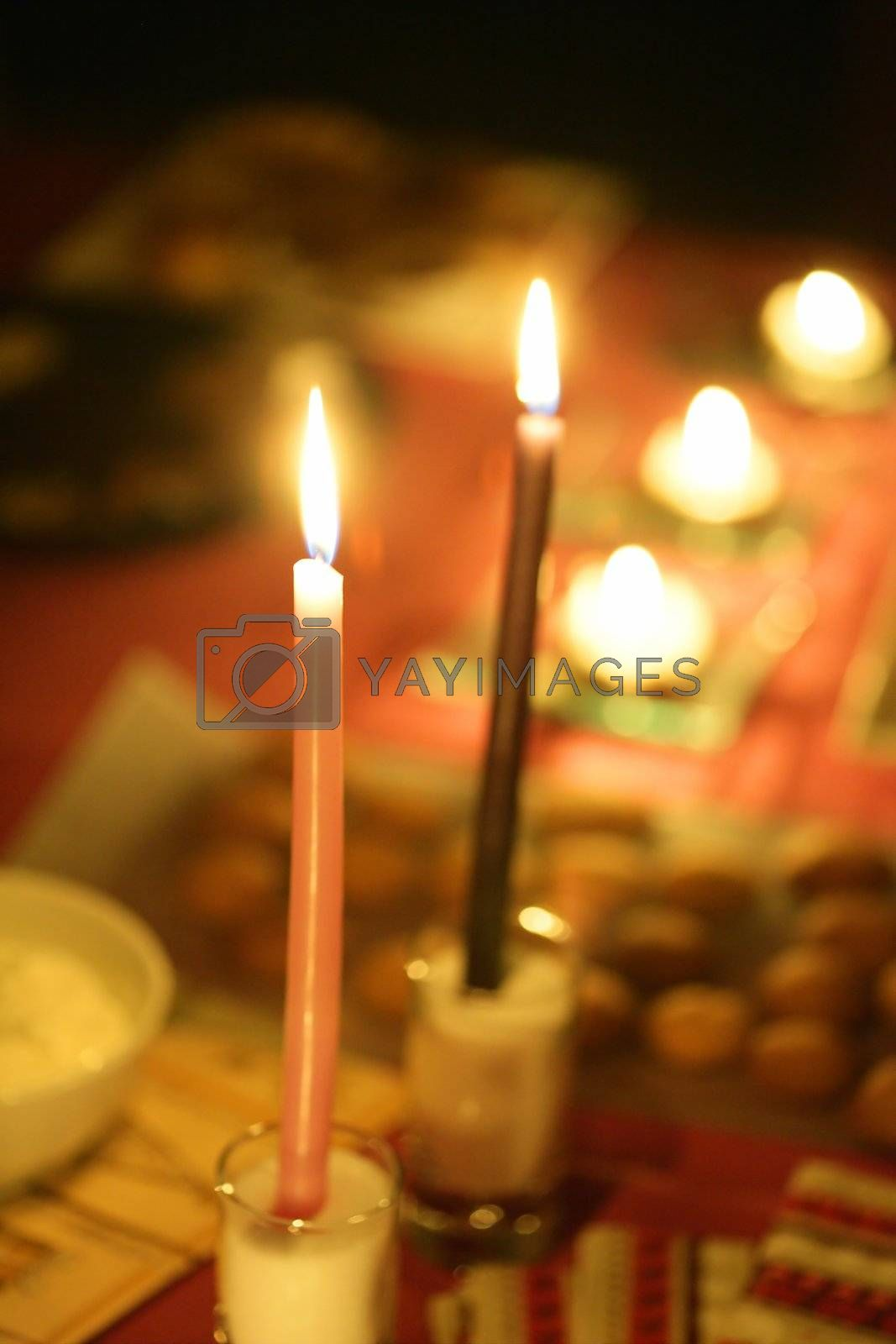 Royalty free image of Candle light in a christmas night by lunamarina
