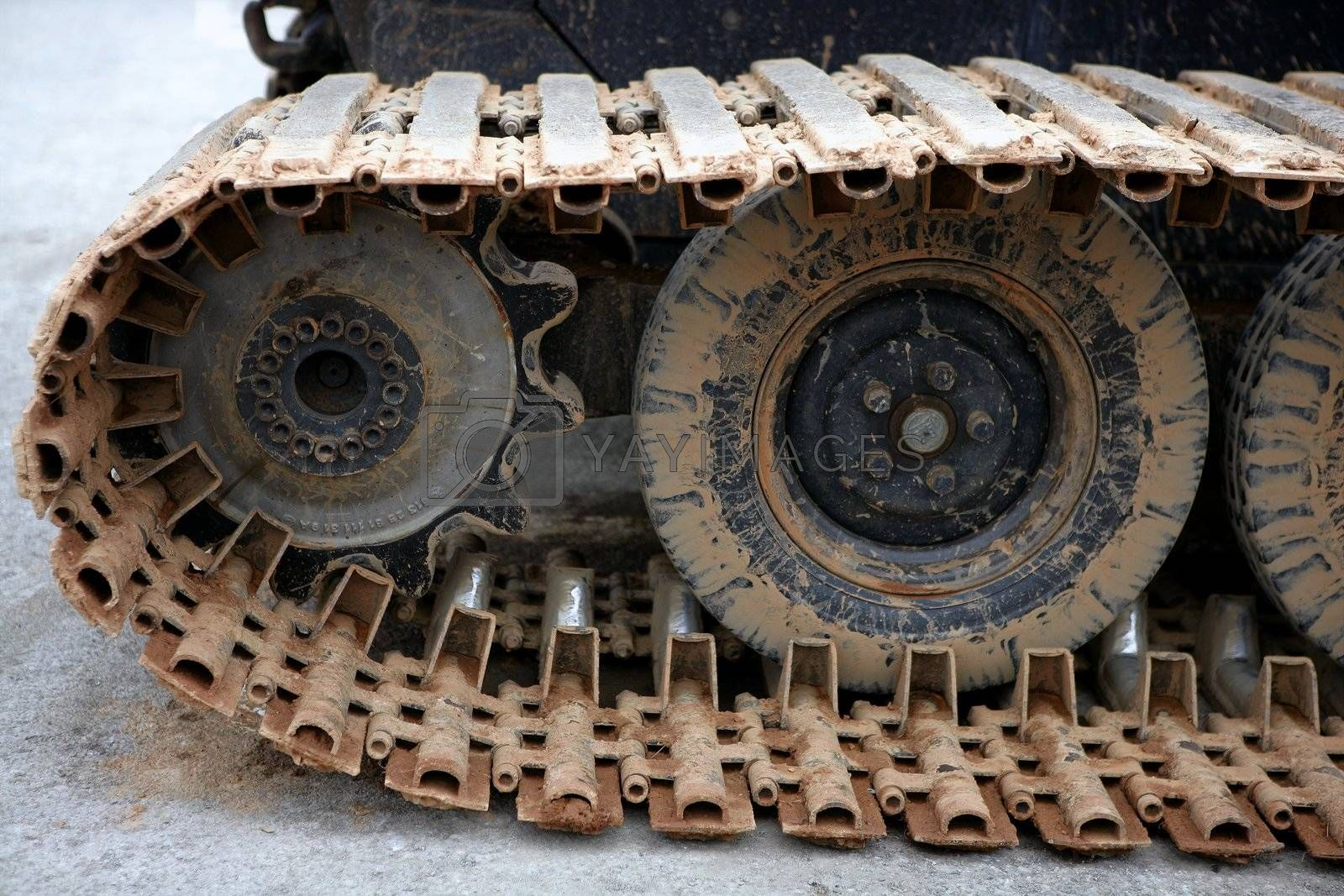 Royalty free image of Caterpillars steel wheels from a snowblower by lunamarina