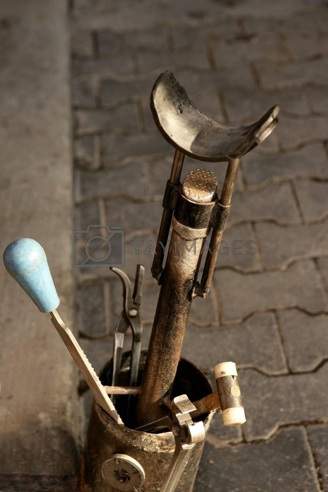 Royalty free image of Horseshoes tools. Professional equipment for horses by lunamarina