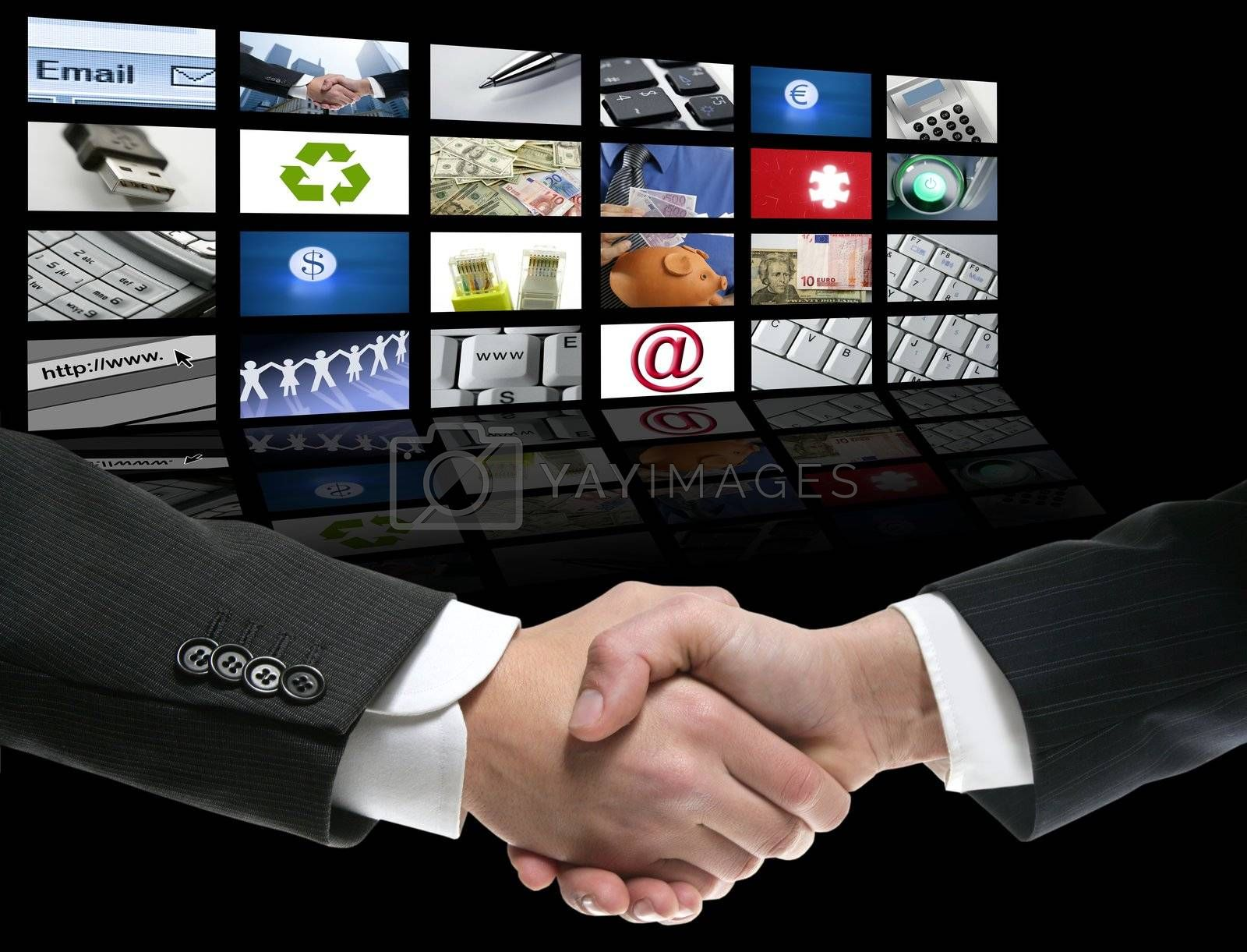Royalty free image of Businessman handshake over perspective screen by lunamarina
