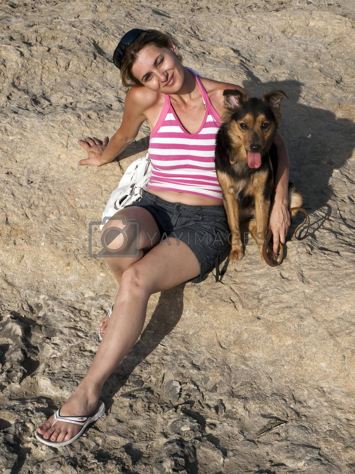 Royalty free image of Woman and Dog by PhotoWorks