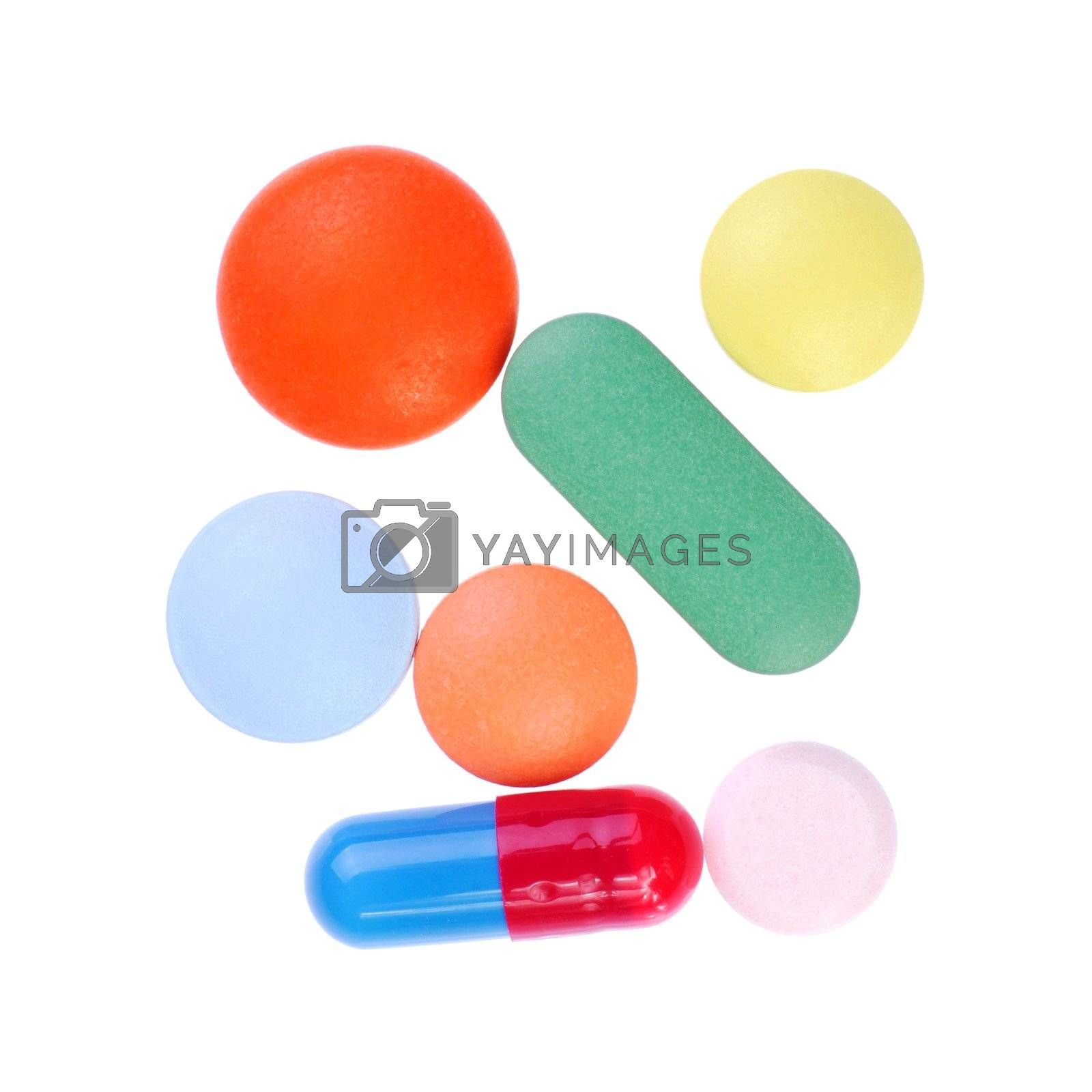 Macro of pills and capsules isolated on white background