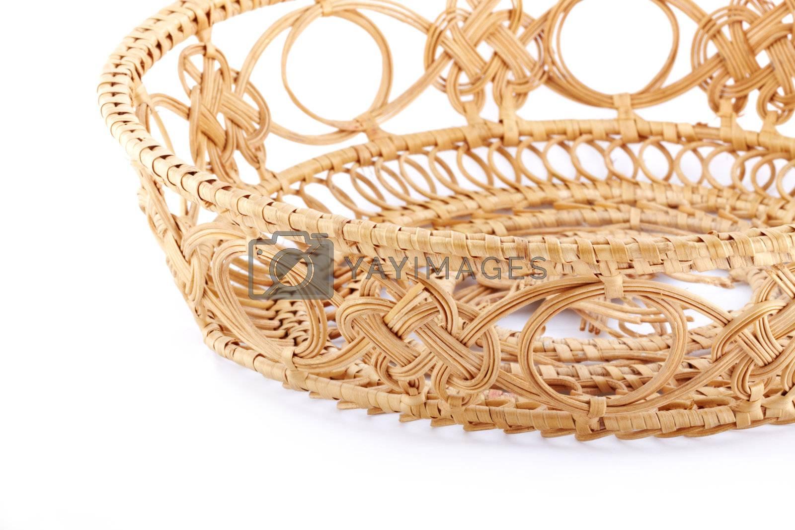 Close up empty wicker basket on white background