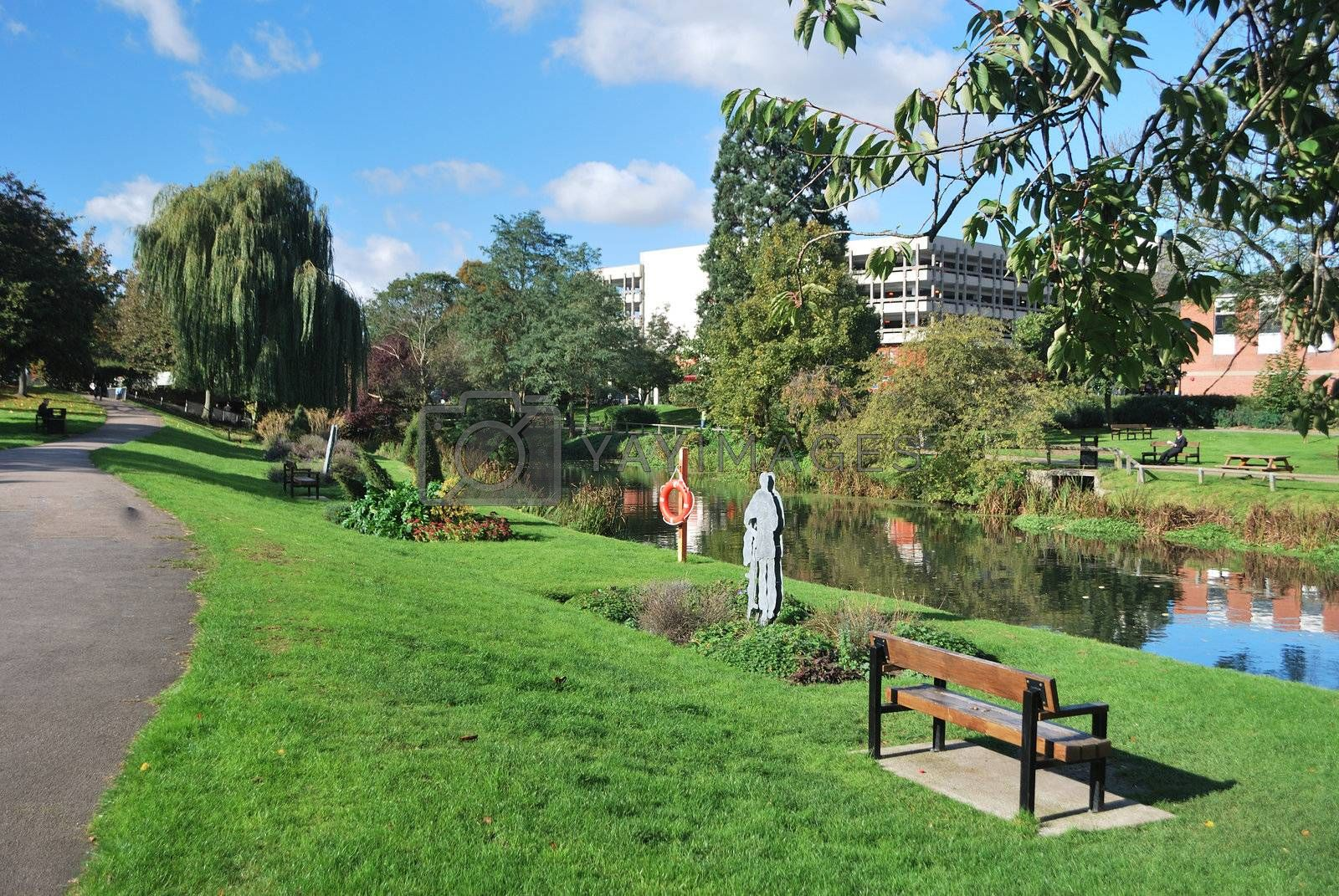 urban park with bench in foreground