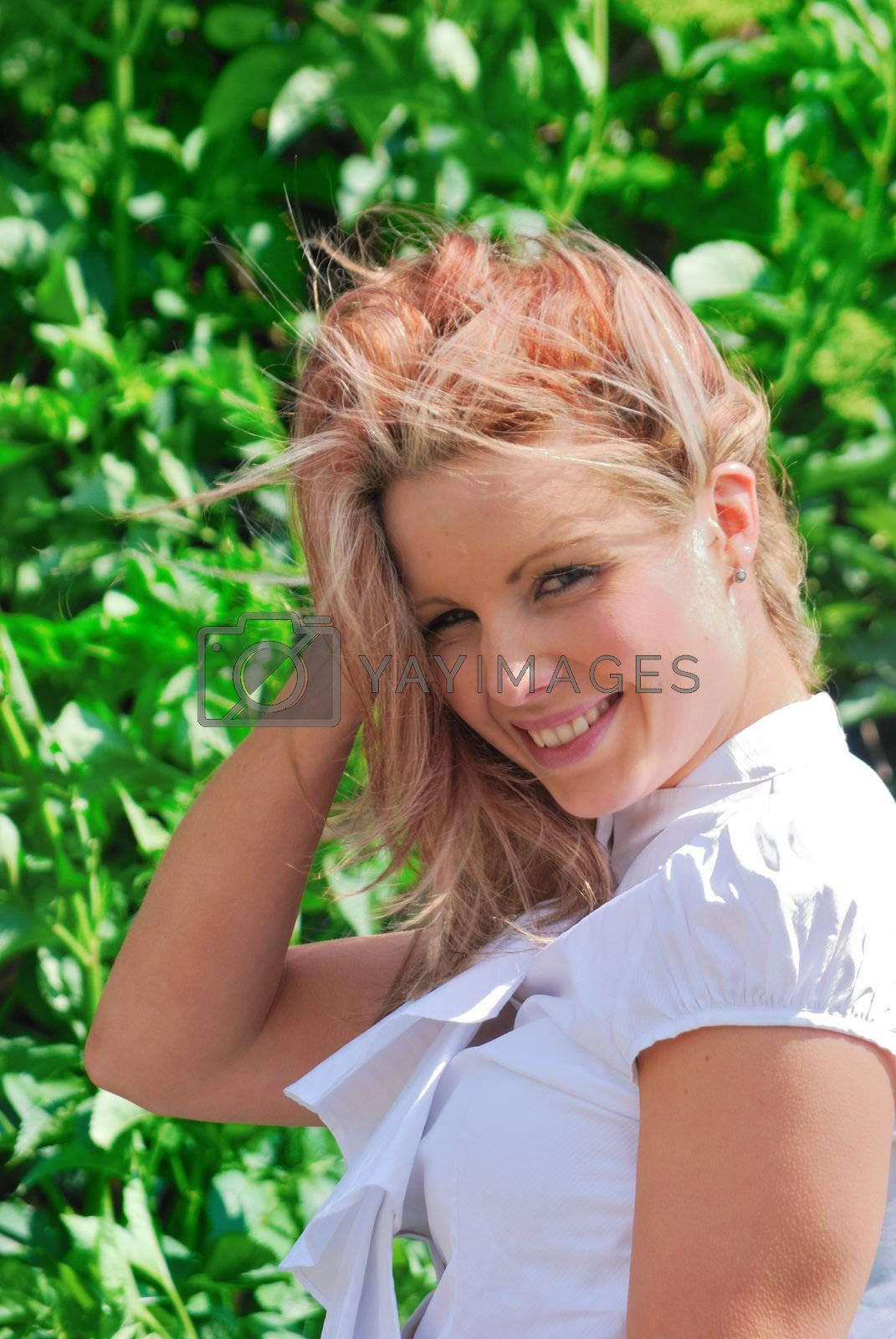 Pretty girl outdoors with leafy background