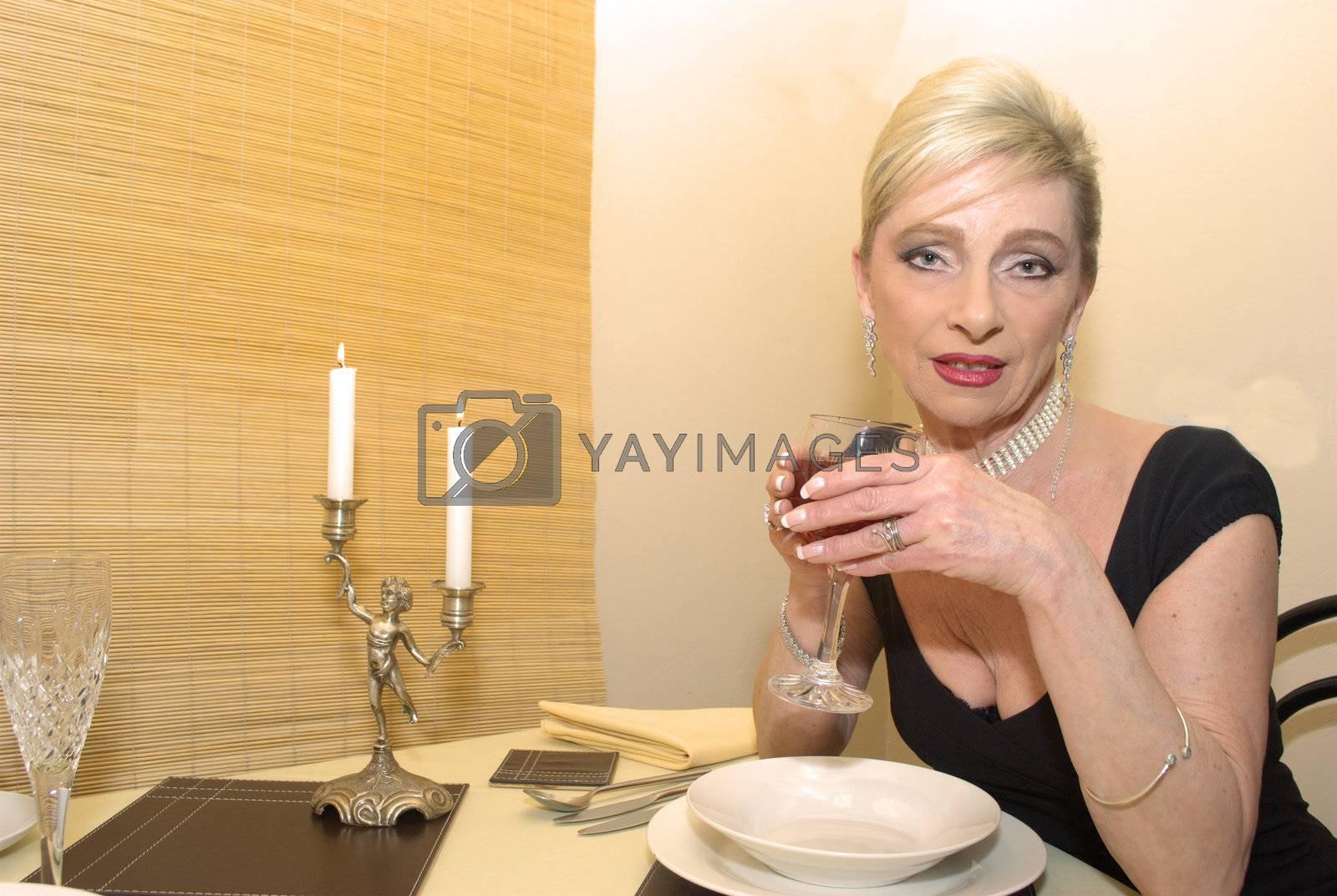 Older woman enjoying a glass of wine