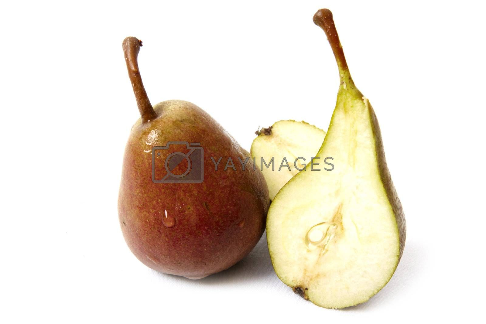 Sliced ripe pear isolated on white background. Photo taken in august, 2009
